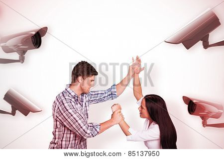 Aggressive man overpowering his girlfriend against cctv camera