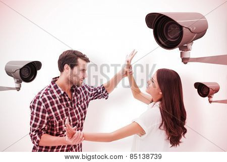 Fearful brunette being overpowered by boyfriend against cctv camera