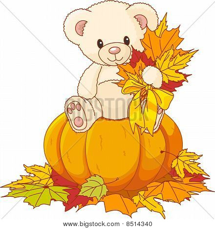 Teddy Bear Sitting On Pumpkin