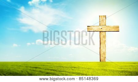 One cross in morning green field with blue heaven