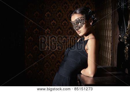 Beautiful mysterious stranger girl in venetian mask. Carnival, masquerade. Jewellery, gems.