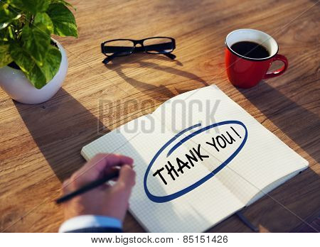 Businessman with Note Pad and the Text Thank You Concept