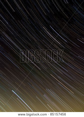 Textile pattern of star trails in the night sky