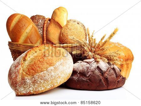 Fresh bread with wheat in wicker basket isolated on white