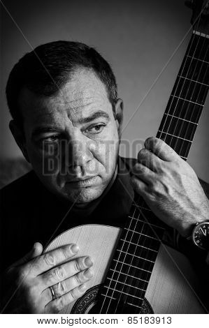 Man with a guitar. Black and white portrait