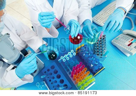 Group of medical doctors in laboratory. Scientific research.