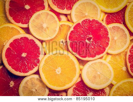 Vintage retro effect filtered hipster style image of colorful citrus fruit - lemon, orange, grapefruit - slices background