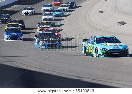 Las Vegas, NV - Mar 08, 2015:  Joey Logano (22) brings his race car through the turns during the Kobalt 400 race at the Las Vegas Motor Speedway in Las Vegas, NV.