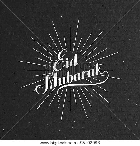 handwritten Eid Mubarak retro label with light rays.