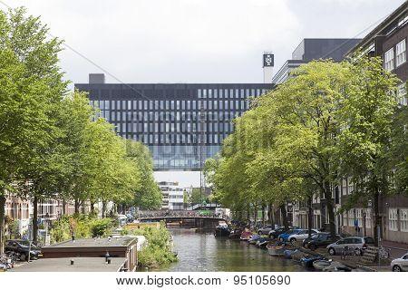 building of Amsterdam university on roeterseiland seen from nieuwe achtergracht