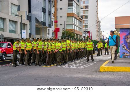 Policemen waiting for Pope Francis Popemobile motorcade comming as his first oficial visit  to Quito