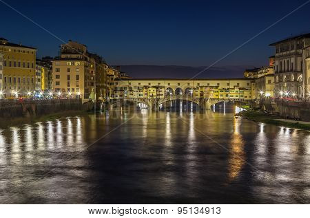 Evening. The Ponte Vecchio (Old Bridge) is a Medieval stone closed-spandrel segmental arch bridge over the Arno River in Florence Italy poster