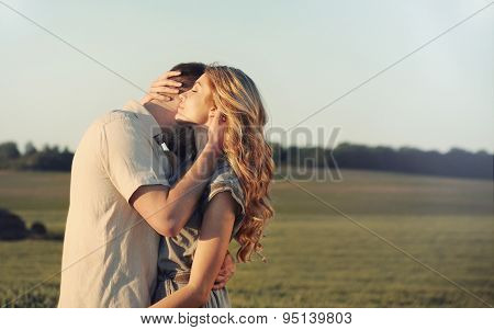 Stunning Sensual Young Couple In Love Embracing At The Sunset