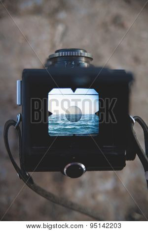 old camera and the sea viewfinder