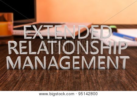 Extended Relationship Management - letters on wooden desk with laptop computer and a notebook. 3d render illustration. poster