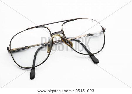 Old vintage eyeglasses on white background