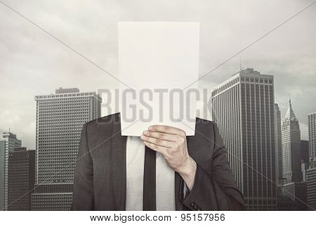 Businessman holding empty paper front of him