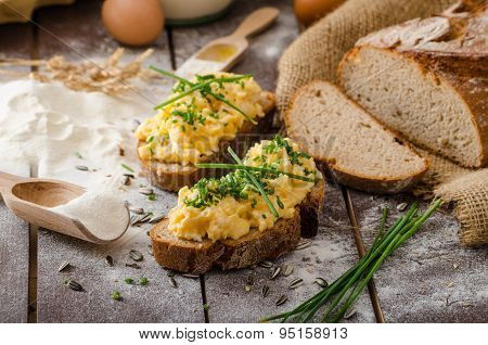 Scrambled eggs with herbs on wheat-rye crispy bread homemade poster