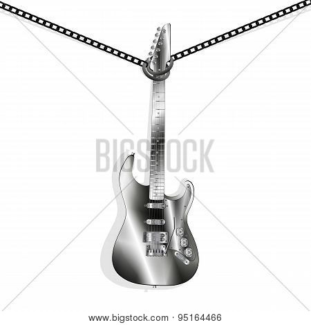 Iron Guitar Hanging On Chains