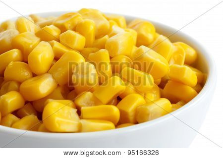 Bowl Of Tinned Sweetcorn Isolated On White. Detail.