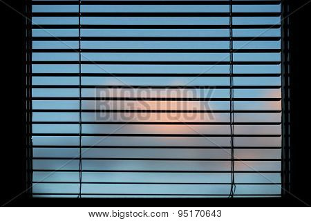 Sky Seen Through Venetian Blinds