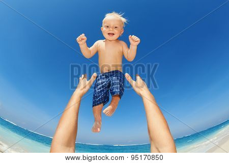Father Throwing Up High In The Air A Happy Child