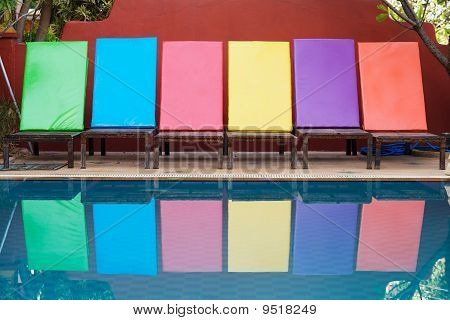 Colored Sun Loungers By Pool