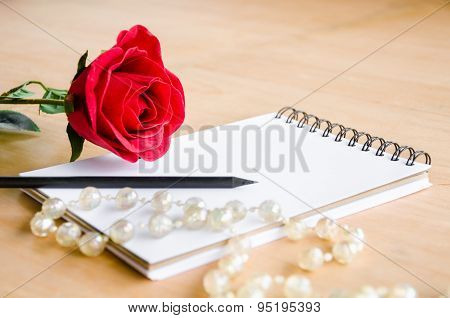 Focus Red Rose With Blank Diary
