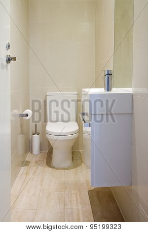 Contemporary Fully Tiled Powder Room Toilet