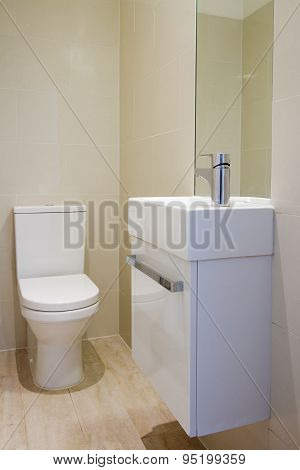 Angled View Of Newly Renovated Bathroom Toilet And Basin