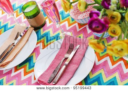 Bright Colorful Table Setting With Chevron Tablecoth