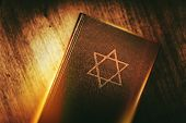 The Book of Judaism. Ancient Prayer Book with Judaism Star of David Symbol on Cover. poster