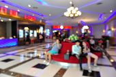 Blur of Defocus Background of People Waiting in Movie or Cinema Complex Lounge poster
