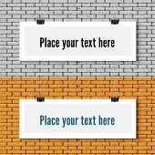 Two Vector horizontal blank white paper poster mock up on the brick wall. Template of paper sheet with clips. Paper card hanging on the rop. poster