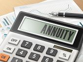calculator with the word annuity on the display poster