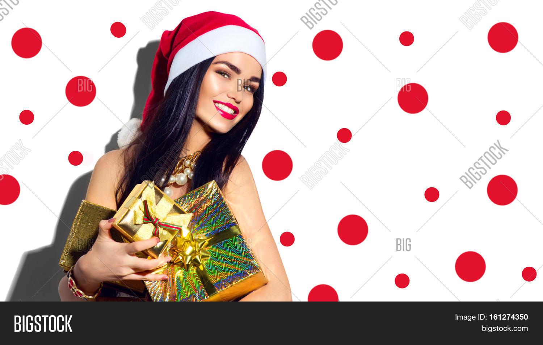 f8ba939002fec Beauty Christmas fashion model girl with Xmas gift boxes