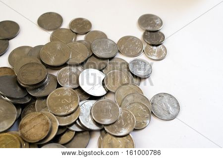 Pile of Indian coins isolated on white. Coins have seen a huge surge in popularity due to the recent demonetization and financial turmoil