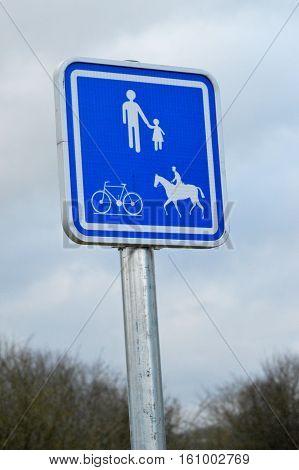 Rectangular road sign for pedestrian access cyclist and horseback riding.