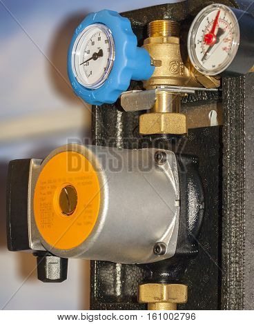Water pump, thermometers, hot and cold water pipes are installed on.