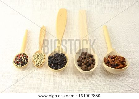 aromatic spices pepper and grinder isolated on white.