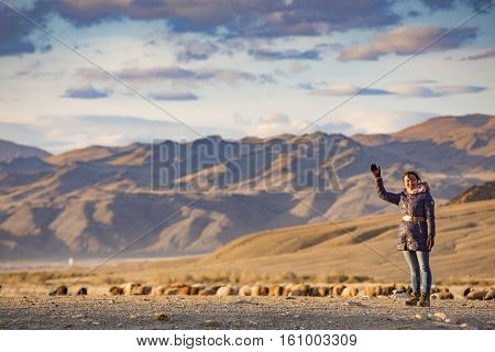 Bayan Ulgii Mongolia October 2nd 2015: young Mongolian woman in a landscape of steppe at sunset