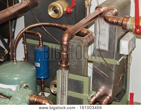 Sensor and temperature control in space heating pipes