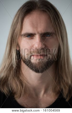 Portrait Of Man With Long Blond Hair Looking In Camera. Closeup Portrait Of Young Boy. Brutal Bull W