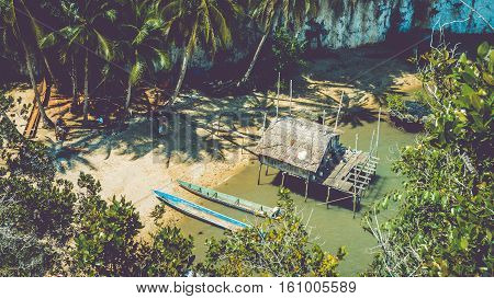 Local people tap new location, Bamboo Hut and Boats on Beach in low Tide, Kabui Bay near Waigeo. West Papuan, Raja Ampat. Indonesia poster