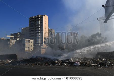 Burning of garbage piling up in city streets in Lebanon.