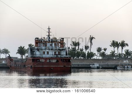 Boat dredger creating land coastline in Souly Bay Salalah Oman 4