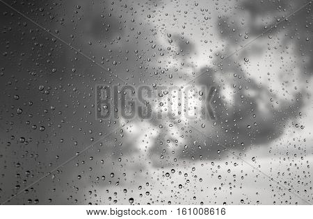 Raindrops on a window during bad, rainy weather