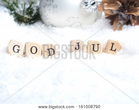 Scandinavian Merry Christmas with the words God Jul in snow