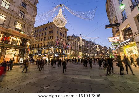 VIENNA AUSTRIA - 2ND DECEMBER 2016: A view along Graben Street at night during the Christmas season. People decorations and buildings can be seen.