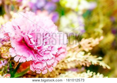 decorative floral bouquet with carnation flower and bookeh background, computer graphic from photography